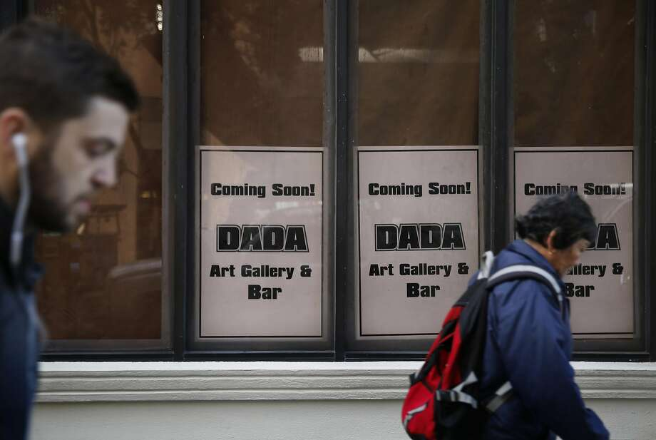 Signs in the windows of 65 Post Street announce DaDa Bar's impending move to a new location, but condo owners whose parking garage is adjacent to the proposed new DaDa location are challenging that move. Photo: Lea Suzuki, The Chronicle