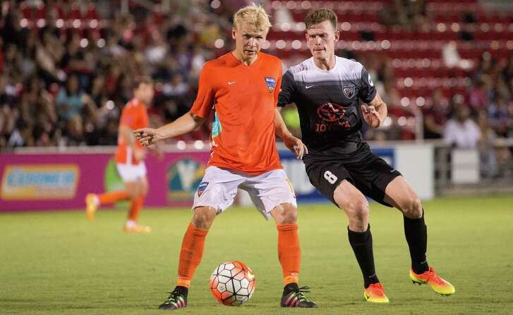 San Antonio FC midfielder Michael Reed (right) guards Orange County Blues FC's Verneri Valimaa during a United Soccer League match in 2016 at Toyota Field in San Antonio.