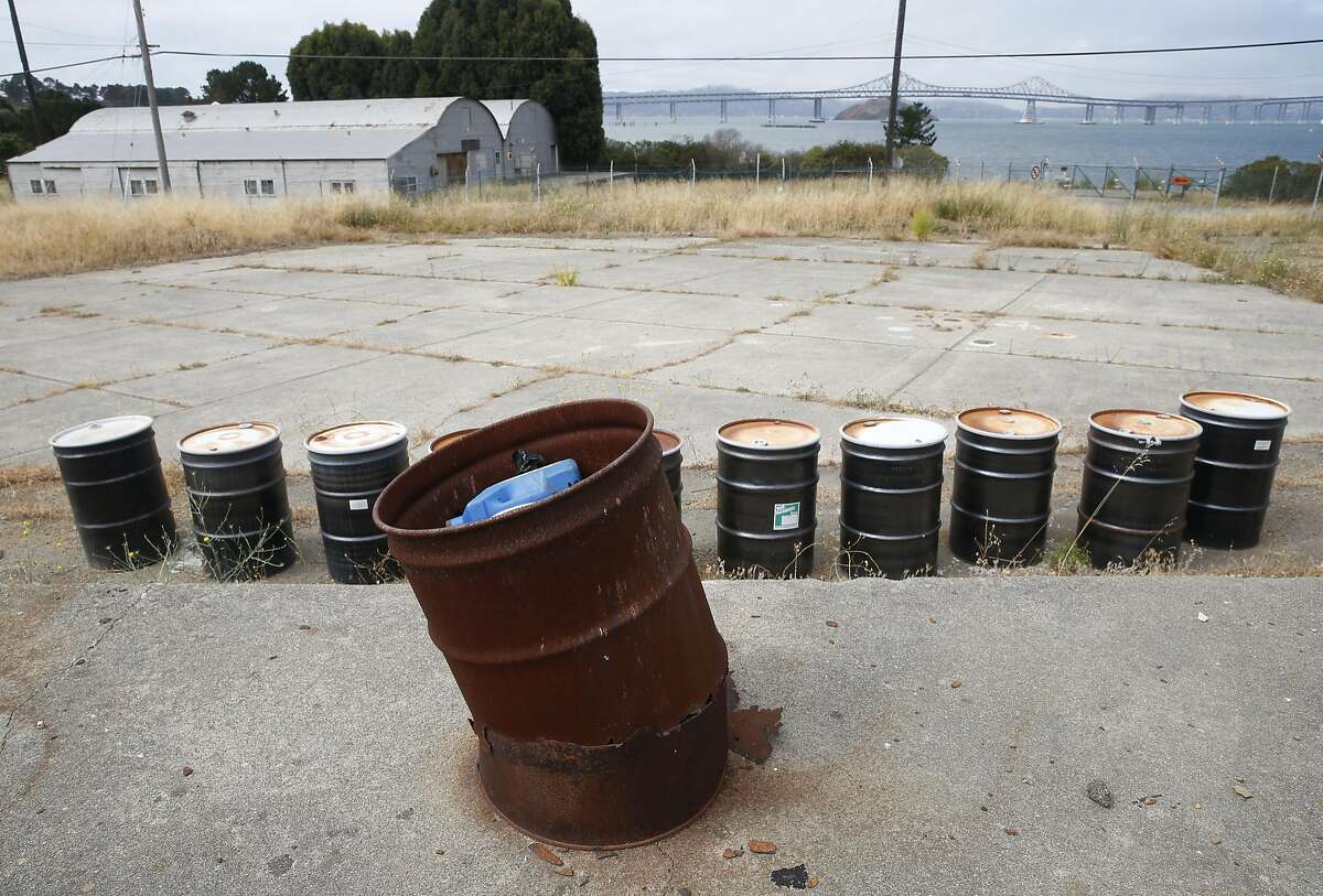 Empty 55-gallon drums remain on an abandoned Navy storage yard, where a developer hopes to build new homes, at Point Molate in Richmond, Calif. on Friday, July 15, 2016. Residents and environmentalists are not happy with a plan by the city's mayor to hand over prime real estate to the developer of a failed casino project at the same location.
