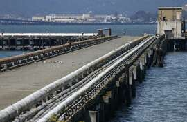 Pipelines from the old Navy fuel depot line a pier at Point Molate in Richmond, Calif. on Friday, July 15, 2016. Residents and environmentalists are not happy with a plan by the city's mayor to hand over prime real estate to the developer of a failed casino project at the same location.