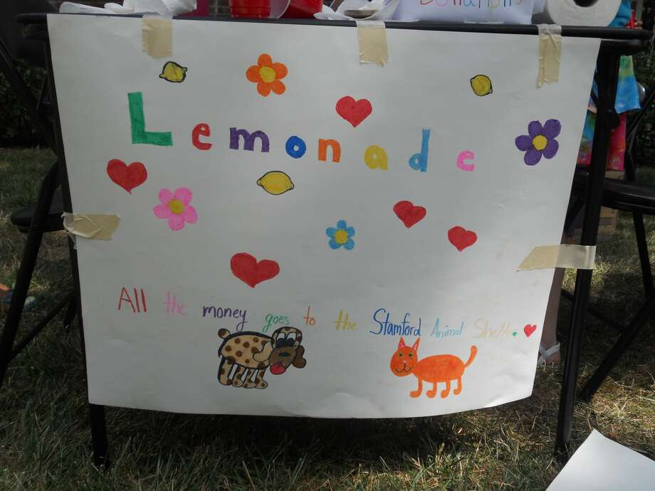 A sign created by 10-year-old Rebecca Beebe and her friends to sell lemonade to benefit the Stamford Animal Shelter. Photo: Submitted By Amy Beebe