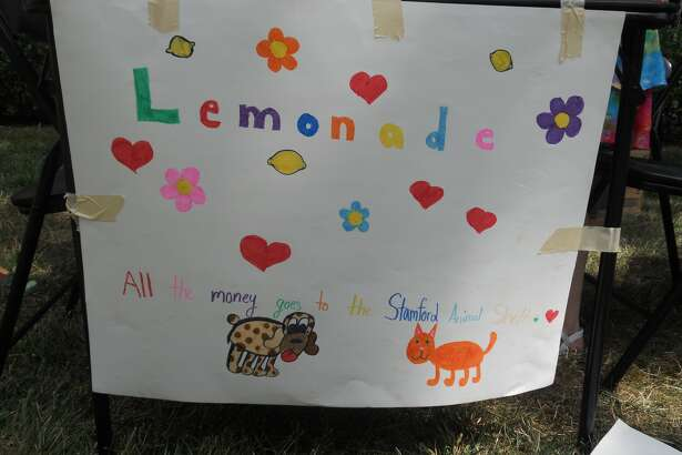 A sign created by 10-year-old Rebecca Beebe and her friends to sell lemonade to benefit the Stamford Animal Shelter.