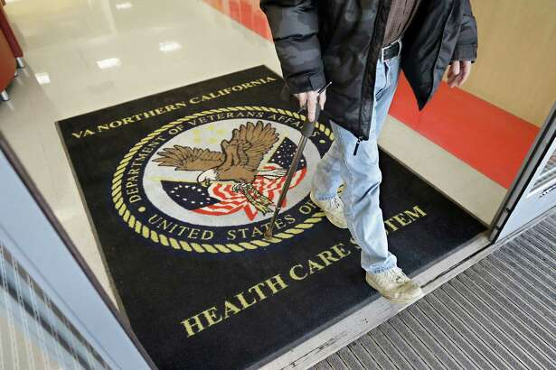 A visitor leaves the Sacramento Veterans Affairs Medical Center in Rancho Cordova, California in 2015 A new report faults the Veterans Health Administration for bad management resulting in long wait times for care and recommends some fixes.
