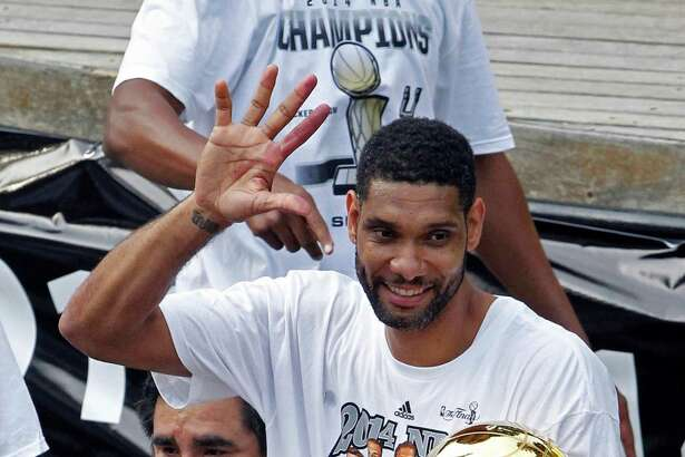 San Antonio Spurs' Tim Duncan in June 2014 shows fans five fingers representing the five NBA basketball titles the Spurs and Duncan have won, during a parade and celebration in San Antonio. Duncan announced his retirement on Monday, July 11, 2016, after 19 seasons, five championships, two MVP awards and 15 All-Star appearances. It marks the end of an era for the Spurs and the NBA.