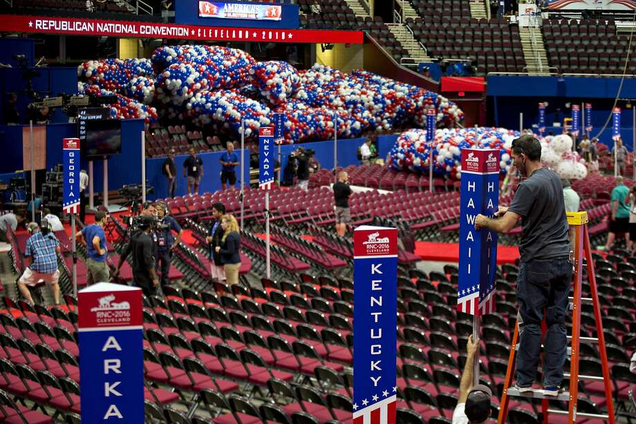 Workers prepare for    the  Republican convention in Cleveland. Photo: Andrew Harrer, Bloomberg