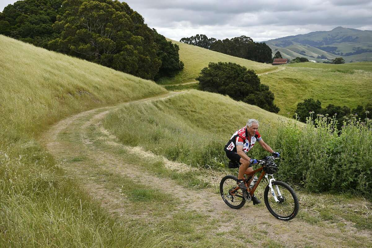 Local resident Charlie Albertalli of Fremont bikes along a trail at Vargas Plateau Regional Park in Fremont, CA, Thursday, May 5, 2016.