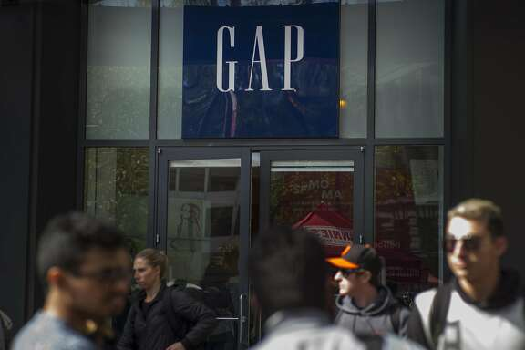Pedestrians walk past a Gap Inc. store in San Francisco, California, U.S., on Friday, May 13, 2016. Gap Inc. is scheduled to release earnings figures on May 19. Photographer: David Paul Morris/Bloomberg