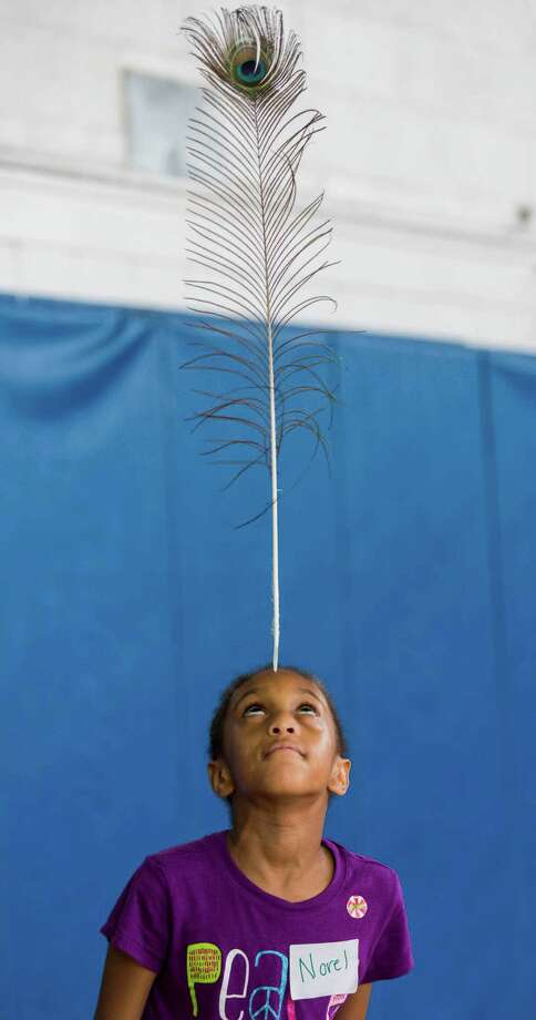Norel Van Dyke balances a feather on her forehead during the Palace Theatre's Circus Camp held at the Yerwood Center, Stamford, CT Thursday, July 14, 2016. Photo: Mark Conrad / For Hearst Connecticut Media / ©Mark F Conrad