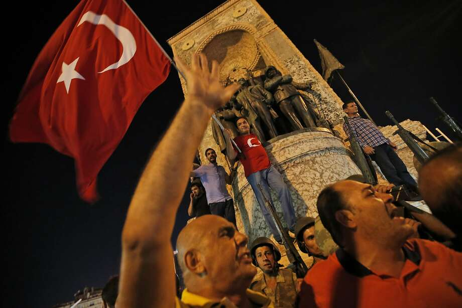 Supporters of Turkish President Recep Tayyip Erdogan protest in front of soldiers in Istanbul's Taksim Square. Photo: Emrah Gurel, Associated Press