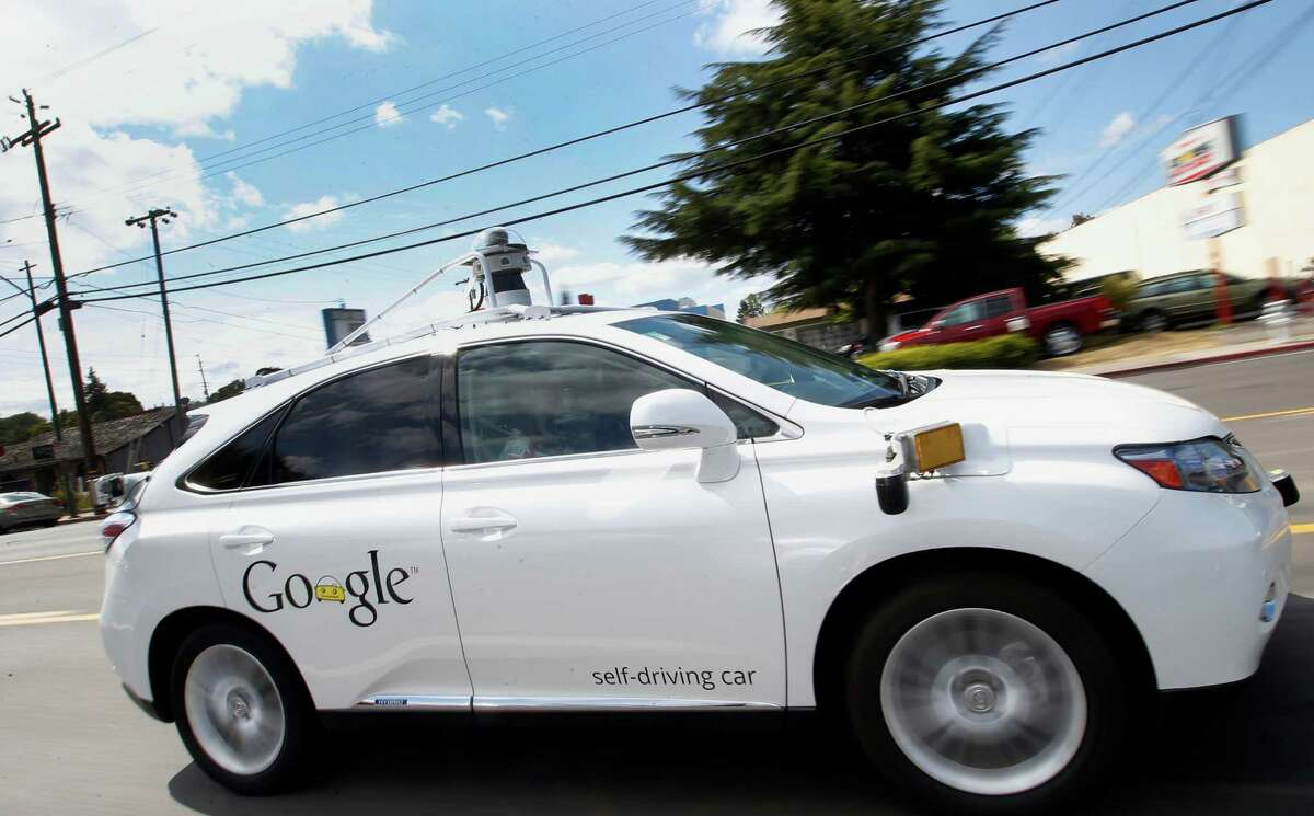 In this May 13, 2015, file photo, Google's self-driving Lexus drives along a street during a demonstration at Google campus in Mountain View, Calif. Testing of self-driving vehicles is expanding, with Texas aggressively luring companies.