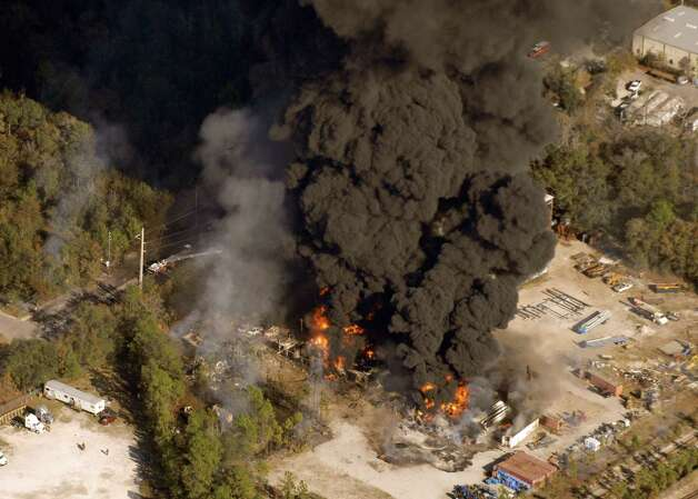 A column of smoke rises from the site of T2 Laboratories after a runaway chemical reaction caused an explosion, killing four. Photo: Bob Self, AP / The Florida Times-Union