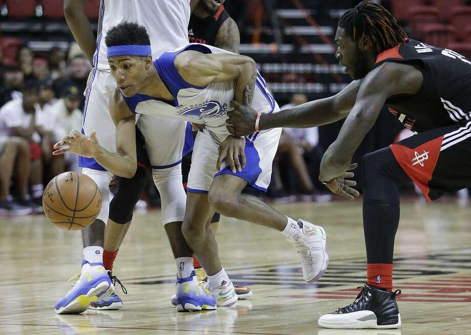 Golden State Warriors' Patrick McCaw, left, drives by Houston Rockets' Montrezl Harrell during the second half of an NBA summer league basketball game, Wednesday, July 13, 2016, in Las Vegas. (AP Photo/John Locher) Photo: John Locher, Associated Press