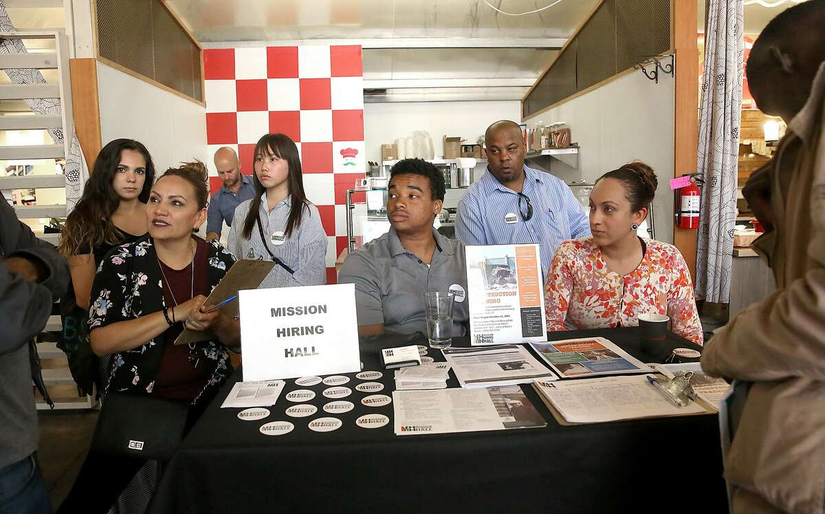 """Mission Hiring Hall , a 46 year old community based organization providing job readiness training, job counseling and placement, and support service referrals, talks about their program at """"The Hall"""" job fair on Monday, July 11, 2016, in San Francisco, Calif."""
