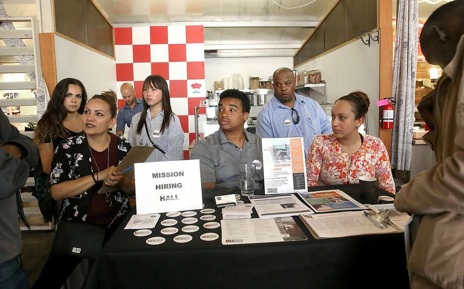 Mission Hiring Hall was one of the organizations at the job fair in the Tenderloin district providing services at the event hosted by the Hall pop-up market in S.F. Photo: Liz Hafalia, The Chronicle