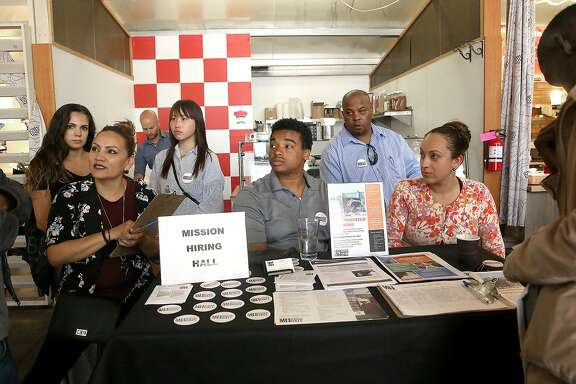 "Mission Hiring Hall , a 46 year old community based organization providing job readiness training, job counseling and placement, and support service referrals, talks about their program at ""The Hall"" job fair on Monday, July 11, 2016, in San Francisco, Calif."