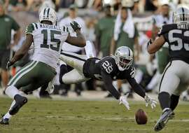 David Amerson (29) dives for a deflected pass intended for Brandon Marshall (15) in the fourth quarter as the Oakland Raiders played the New York Jets at O.co Coliseum in Oakland, Calif., on Sunday, November 1, 2015.