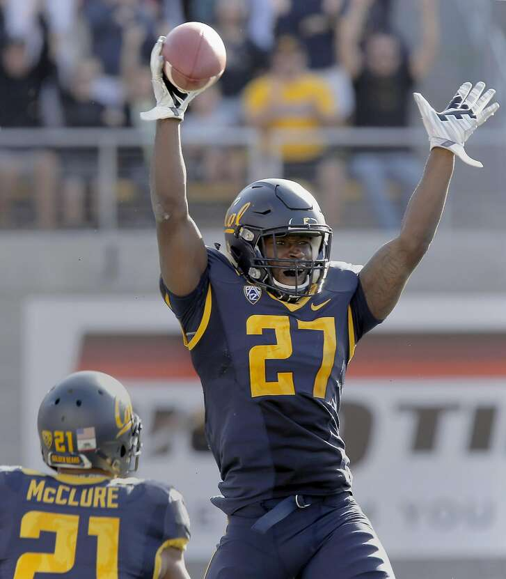 Cal's Damariay Drew celebrates his interception late in the fourth quarter, as the California Bears went on to beat the Washington State Cougars 34-28, at Memorial Stadium in Berkeley, Calif., on Sat. October 3, 2015.