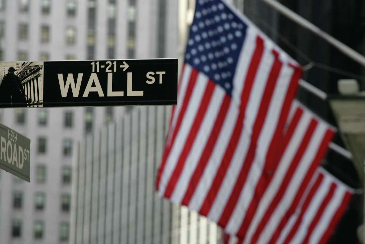 FILE - In this Sept. 17, 2008 file photo, a Wall Street sign is shown in New York. Stocks are rising modestly in early morning trading Friday, July 15, 2016 as the market extends a winning streak into a sixth day. (AP Photo/Mark Lennihan) ORG XMIT: NY111