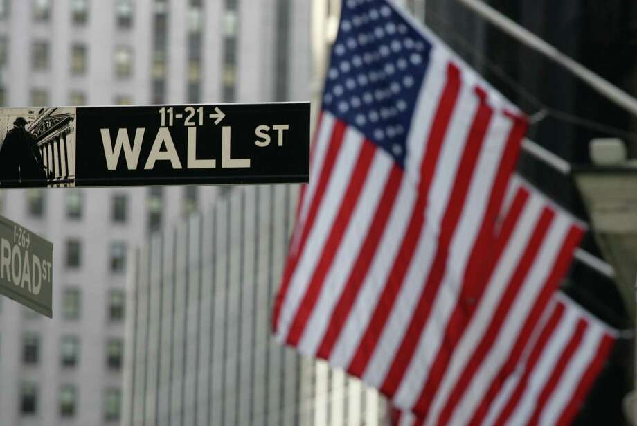 FILE - In this Sept. 17, 2008 file photo, a Wall Street sign is shown in New York.  Stocks are rising modestly in early morning trading Friday, July 15, 2016 as the market extends a winning streak into a sixth day.   (AP Photo/Mark Lennihan) ORG XMIT: NY111 Photo: Mark Lennihan / AP
