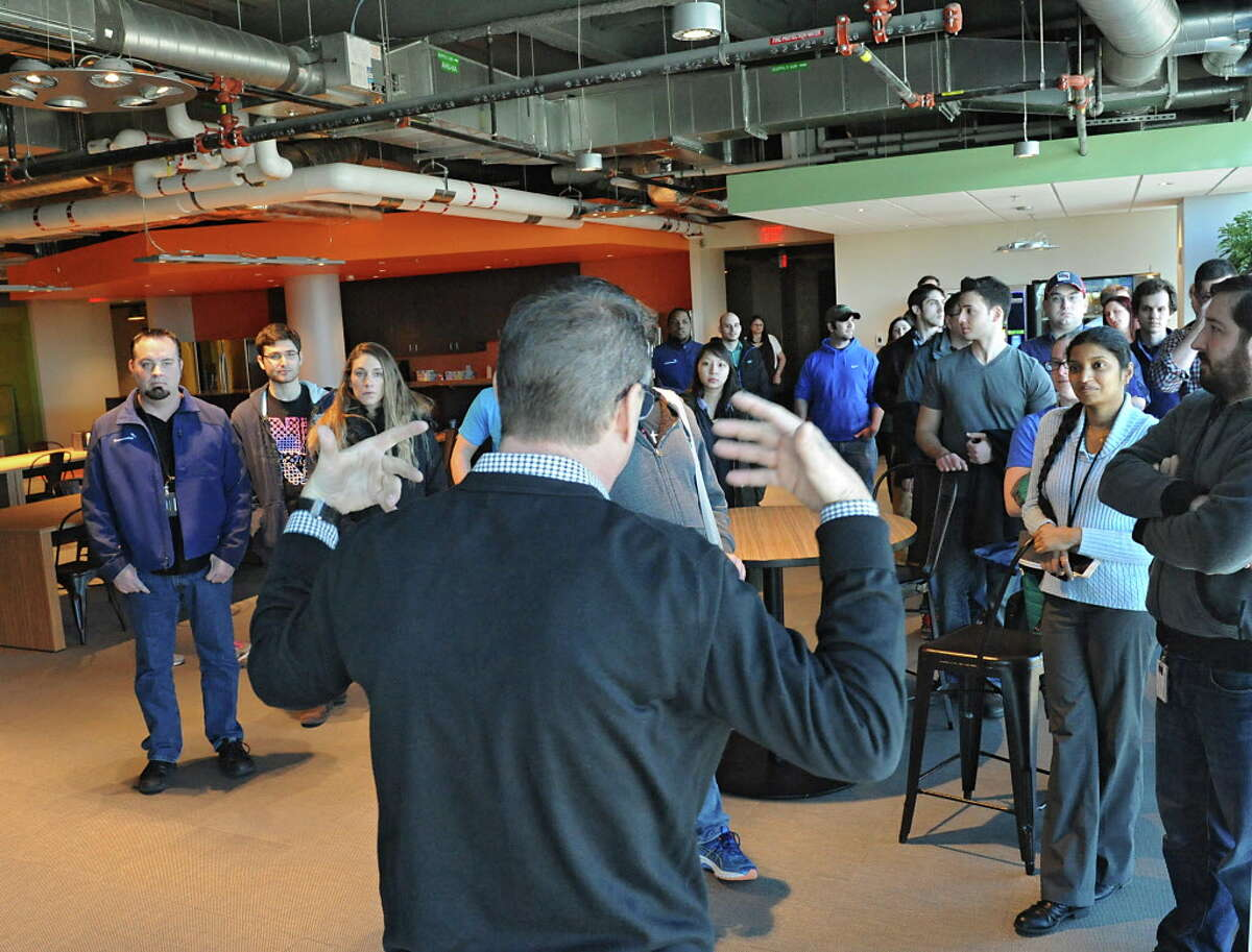 CommerceHub CEO Frank Poore, center gives his employees their first look at the newly finished space in ZEN building at SUNY Polytechnic Institute back in March. The company is going public next week. (Lori Van Buren / Times Union)