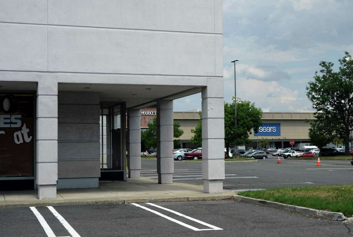 The former Sears Auto Center, left, at Colonie Center, now closed, houses Avis and Budget car rental companies Friday July 15, 2016 in Colonie, NY. (John Carl D'Annibale / Times Union)