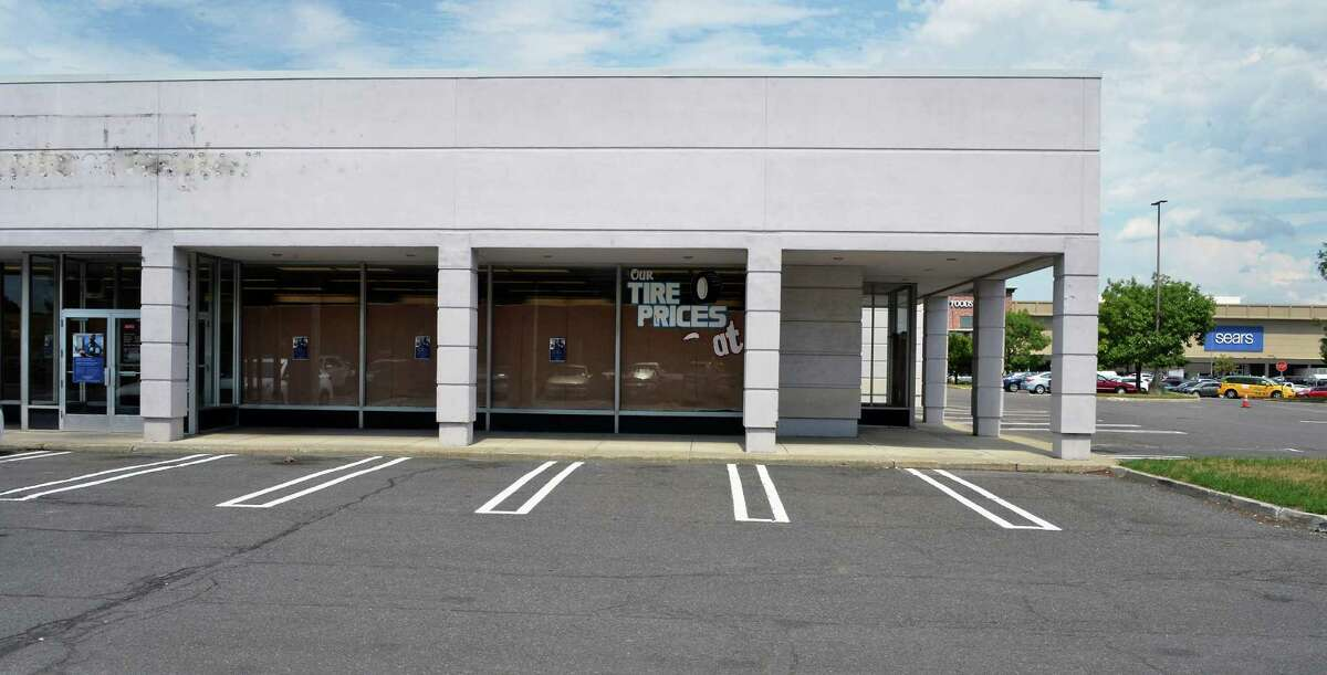 The former Sears Auto Center at Colonie Center, now closed, houses Avis and Budget car rental companies Friday July 15, 2016 in Colonie, NY. (John Carl D'Annibale / Times Union)
