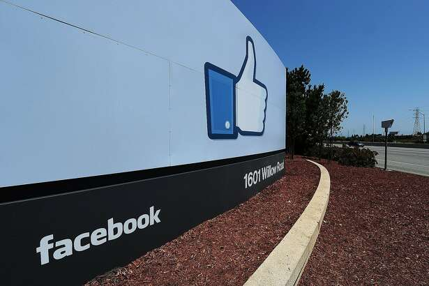 """(FILES) This May 15, 2012 file photo shows the sign at the entrance to the Facebook main campus in Menlo Park, California.  Facebook tightened the reins on October 2, 2014 on its research methods in the wake of an outcry by members who felt manipulated by a secret study into how posts affect moods. The world's biggest social network announced that a panel of senior personnel from a range of teams was created to review proposed research projects, which will go through advanced scrutiny to make certain they fall within acceptable guidelines. """"We're committed to doing research to make Facebook better, but we want to do it in the most responsible way,"""" chief technology officer Mike Schroepfer said in a blog post. AFP PHOTO / ROBYN BECKROBYN BECK/AFP/Getty Images"""