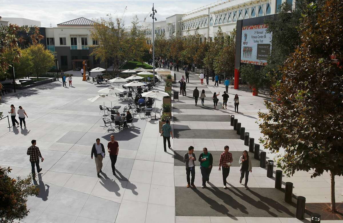 People walk around on the Facebook campus Nov. 12, 2014 in Menlo Park, Calif.