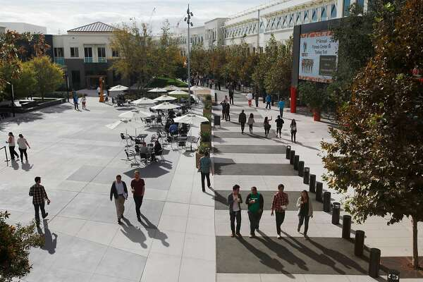 People walk around on the Facebook campus Nov. 12, 2014 in Menlo Park, Calif.