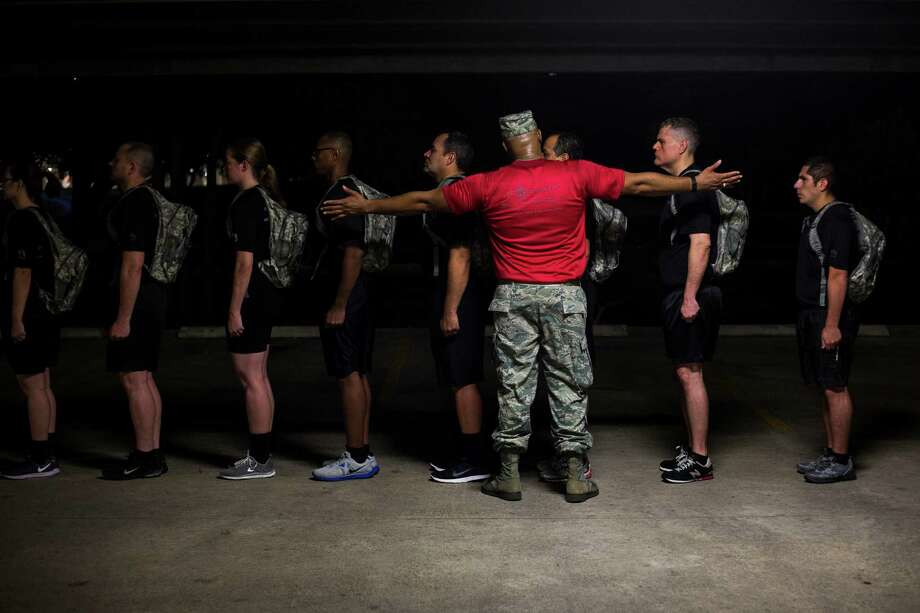Employees form into a line and are addressed by during the USAA Zero Day PT held at USAA's San Antonio head quarters on Friday, July 15, 2016. Photo: BRITTANY GREESON, Staff / San Antonio Express-News / © 2016 San Antonio Express-News