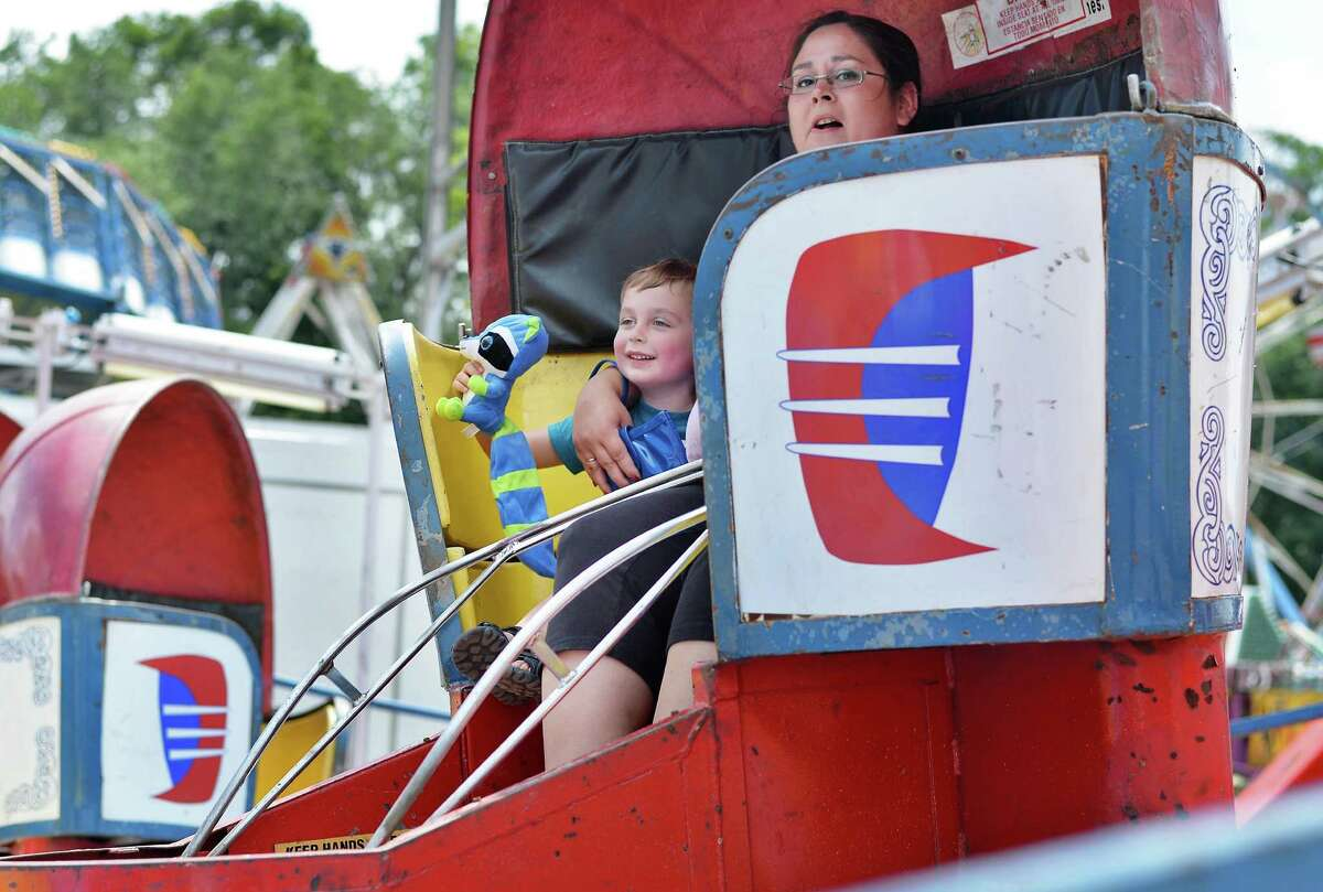 Nikki Leduc and son Nolan of Mechanicville ride the Tilt-a-whirl as the Saratoga County Fair begins Tuesday July 21, 2015 in Ballston Spa, NY. (John Carl D'Annibale / Times Union)