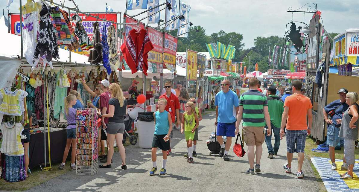 Fair goers crowd the midway as the Saratoga County Fair begins Tuesday July 21, 2015 in Ballston Spa, NY. (John Carl D'Annibale / Times Union)