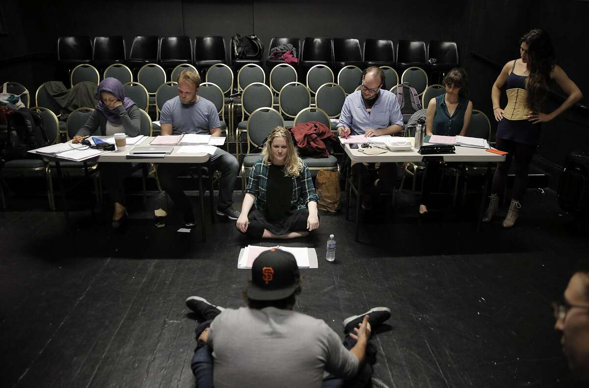 The Breadbox artistic director Ariel Craft, center, works with actors during rehearsal for The Awakening.