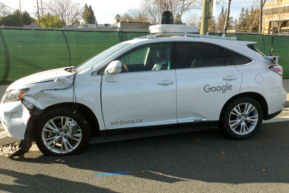 This Feb. 14, 2016, photo provided by the Santa Clara Valley Transportation Authority shows damage to a self-driving Lexus SUV, operated by Google, that collided with a public bus in Mountain View, Calif. Cameras aboard the bus recorded the Lexus edging into the path of the bus and hitting its right side. (Santa Clara Valley Transportation Authority via AP) MANDATORY CREDIT