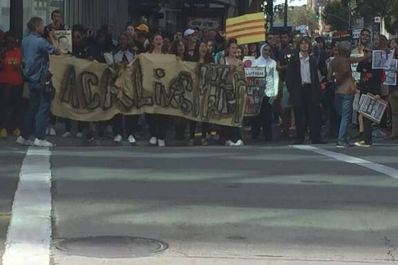 Protesters took to the streets of downtown Oakland Friday afternoon to demand justice for Philando Castile in Minnesota and Alton Sterling in Louisiana, two black men shot to death by police.