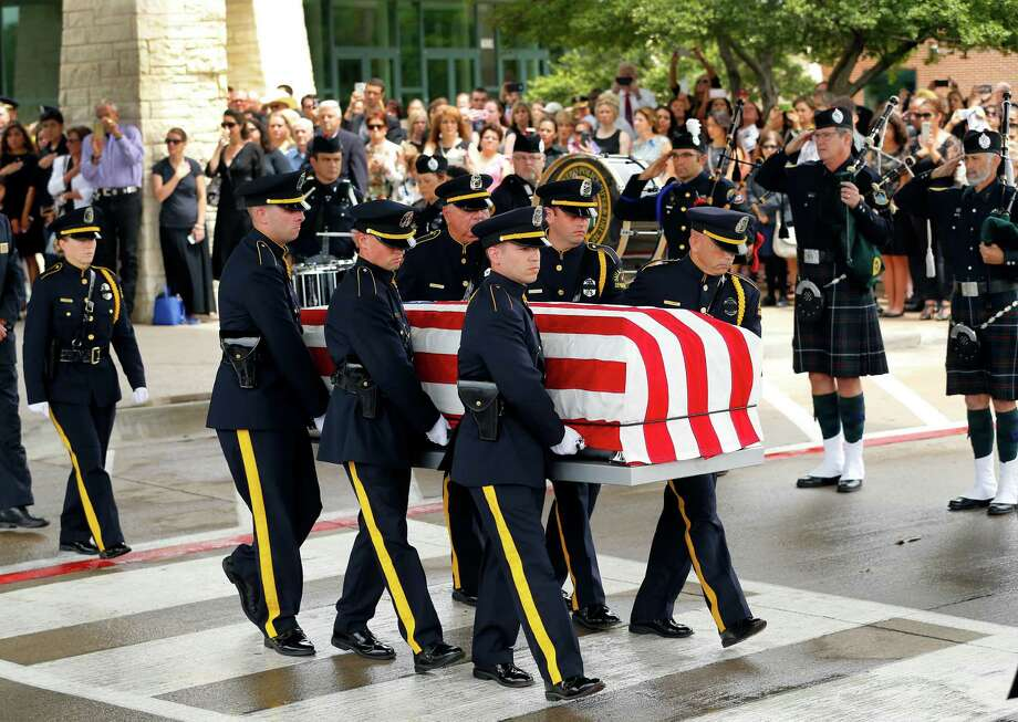 The Dallas Police Honor Guard carries the flag-draped casket of Dallas police officer Michael Krol to a ceremony outside of Prestonwood Baptist Church in Plano, Texas, Friday, July 15, 2016. Krol was gunned down in an ambush attack in downtown Dallas a week ago. Four Dallas police officers and one DART officer were killed and several survived. (Tom Fox/The Dallas Morning News, pool photo) Photo: Tom Fox / Staff Photographer / The Dallas Morning News