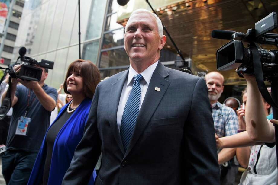 Indiana Gov. Mike Pence and his wife Karen leave a meeting with Republican presidential candidate Donald Trump at Trump Tower in New York, Friday. (AP Photo/Evan Vucci) Photo: Evan Vucci, STF / Copyright 2016 The Associated Press. All rights reserved. This material may not be published, broadcast, rewritten or redistribu