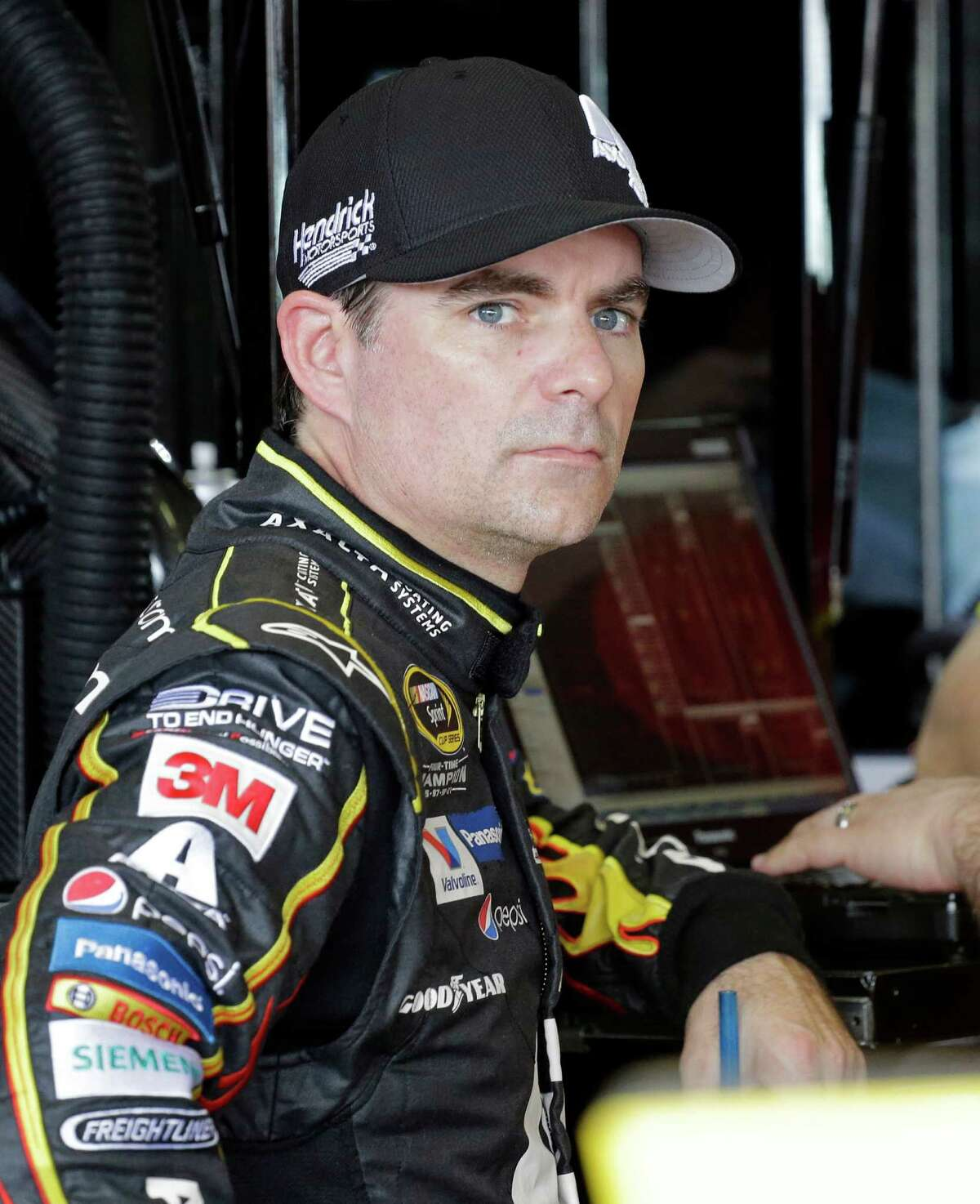 Jeff Gordon looks on in the garage area before the NASCAR Sprint Cup Series practice auto race, Saturday, Nov. 21, 2015, at Homestead-Miami Speedway in Homestead, Fla. (AP Photo/Terry Renna) ORG XMIT: FLHM106