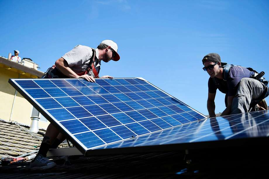 SunRun installers Will LaRocque and Brandon Anderson install one of 28 Q-Cell panels on a home on Friday, July 15, 2016 in Sunnyvale. Photo: Michael Noble Jr., The Chronicle