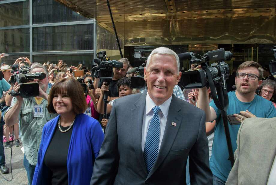 Gov. Mike Pence of Indiana and his wife, Karen, leave the Intercontinental Hotel in New York after a meeting with Donald Trump, who named his running mate. Photo: Bryan R. Smith / New York Times / NYTNS
