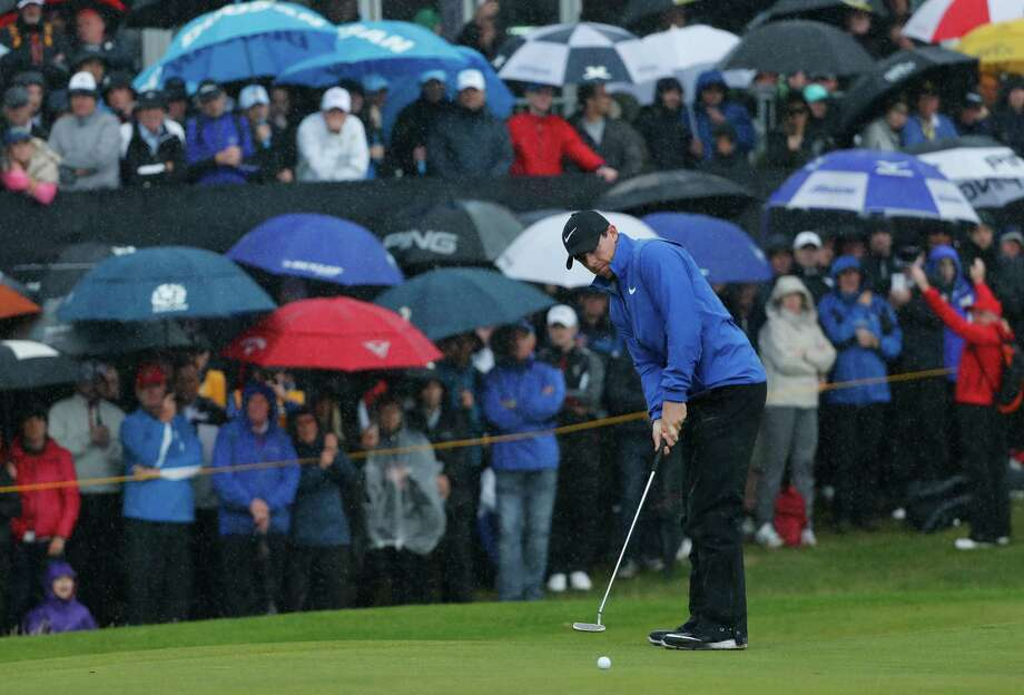 Rory McIlroy of Northern Ireland puts on the 12th green during the second round of the British Open Golf Championship at the Royal Troon Golf Club in Troon, Scotland, Friday, July 15, 2016. (AP Photo/Ben Curtis) Photo: Ben Curtis, STF / Copyright 2016 The Associated Press. All rights reserved. This material may not be published, broadcast, rewritten or redistribu