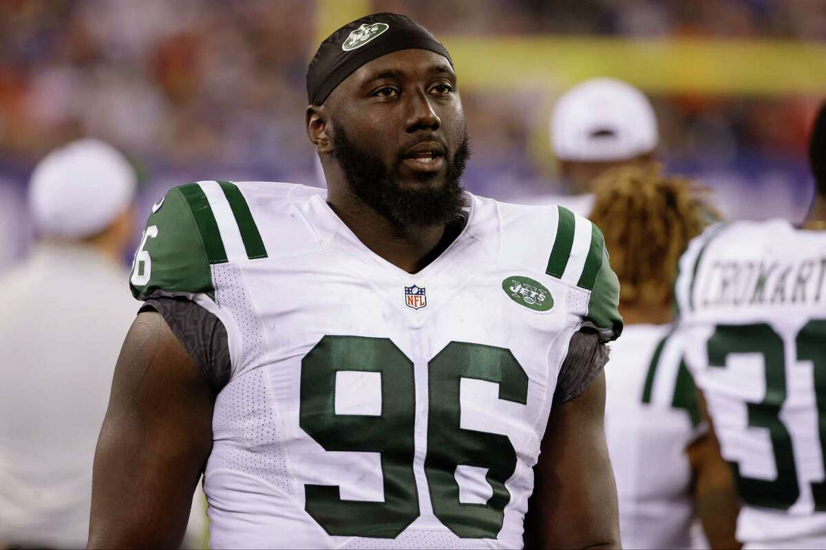 FILE - In this Saturday, Aug. 29, 2015 file photo, New York Jets defensive end Muhammad Wilkerson (96) walks the sidelines during the second half of a preseason NFL football game against the New York Giants in East Rutherford, N.J. The New York Jets have signed Muhammad Wilkerson to a five-year contract extension, beating the deadline after which the Pro Bowl defensive end would have had to play this season under the franchise tag amount of $15.7 million, Friday, July 15, 2016. (AP Photo/Seth Wenig, File) ORG XMIT: NY199