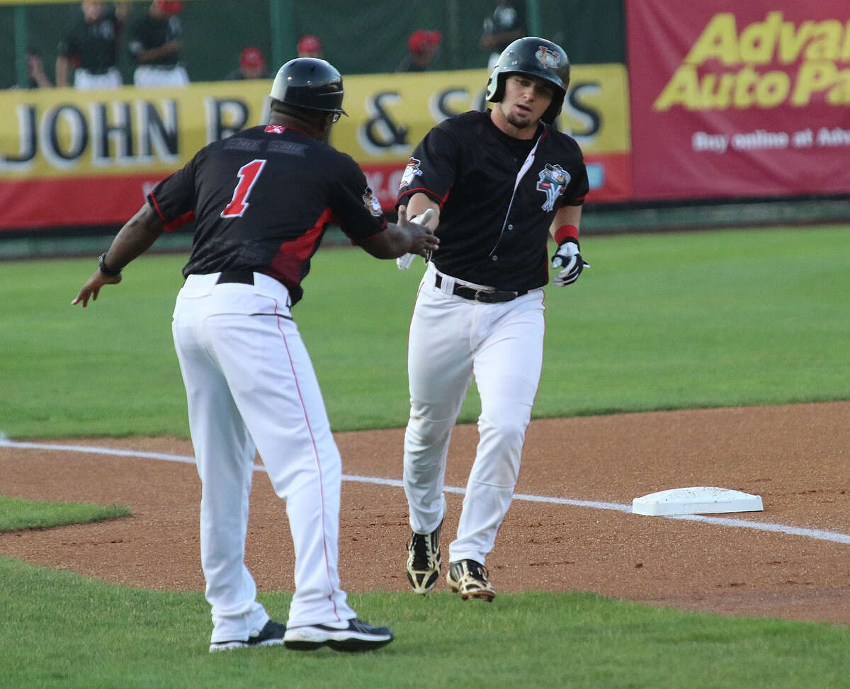ValleyCats manager LaMarr Rogers congratulates Ryne Birk as he rounds third on his way home after a 1st inning solo home run during Friday evening's matchup July 15, 2016 at Joe Bruno Stadium in Troy, N.Y. (Ed Burke/Special to The Times Union)