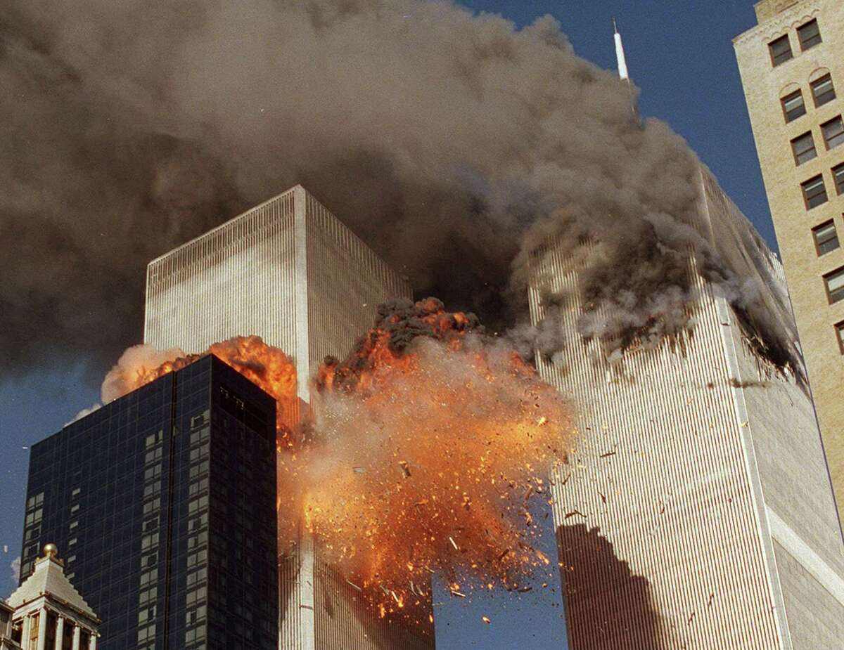 FILE- In this Sept. 11, 2001 file photo, smoke billows from World Trade Center Tower 1 and flames explode from Tower 2 as it is struck by American Airlines Flight 175, in New York. The government is preparing to release a once-classified chapter of a congressional report about the attacks of Sept. 11, that questions whether Saudi nationals who helped the hijackers with things like finding apartments and opening bank accounts knew what they were planning. House Minority Leader Nancy Pelosi said Friday July 15, 2016, that the release of the 28-page chapter is