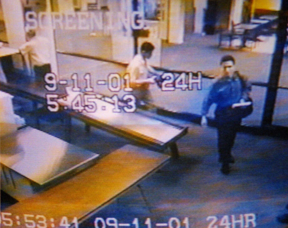 FILE- In this Sept. 11, 2001 file photo from airport surveillance tape released Sept. 19, 2001, two men, identified by authorities as suspected hijackers Mohamed Atta, right, and Abdulaziz Alomari, center, pass through airport security at Portland International Jetport before boarding a commuter flight to Boston for American Airlines Flight 11 which was one two jetliners crashed into the World Trade Center. / 2001 AP