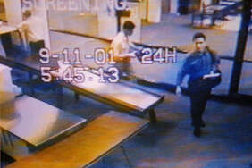 FILE- In this Sept. 11, 2001 file photo from airport surveillance tape released Sept. 19, 2001, two men, identified by authorities as suspected hijackers Mohamed Atta, right, and Abdulaziz Alomari, center, pass through airport security at Portland International Jetport before boarding a commuter flight to Boston for American Airlines Flight 11 which was one two jetliners crashed into the World Trade Center.