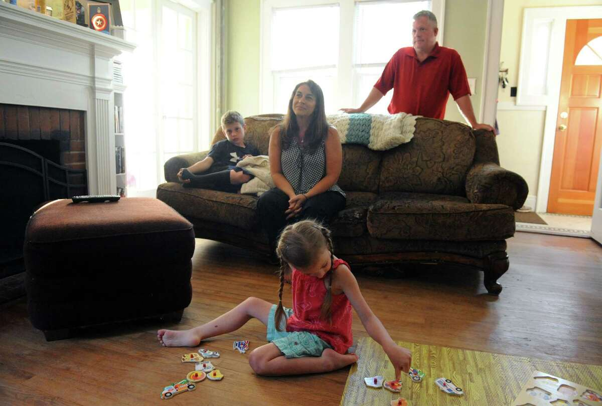 Seven-year-old Adrenne Kelly who has a rare form of epilepsy with her parents Bill and Kim Kelly and brother Will, 10, at their home on Wednesday July 13, 2016 in Albany , N.Y. Adrenne is in a medical marijuana drug trial at NYU. (Michael P. Farrell/Times Union)
