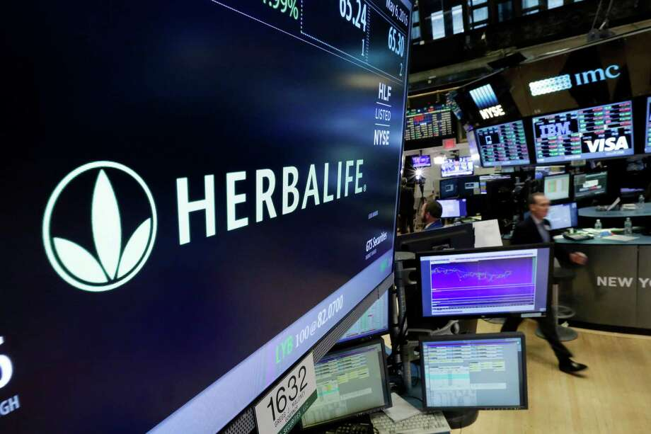 Herbalife will pay $200 million in consumer relief, hire an out-side monitor and make major changes to its business practices. Photo: Richard Drew, STF / Copyright 2016 The Associated Press. All rights reserved. This material may not be published, broadcast, rewritten or redistribu