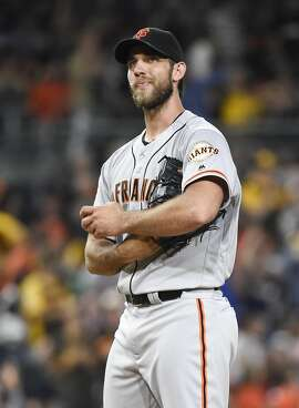SAN DIEGO, CALIFORNIA - JULY 15:  Madison Bumgarner #40 of the San Francisco Giants stands on the mound after giving up a solo home run to Adam Rosales #9 of the San Diego Padres during the fourth  inning of a baseball game at PETCO Park on July 15, 2016 in San Diego, California.   (Photo by Denis Poroy/Getty Images)