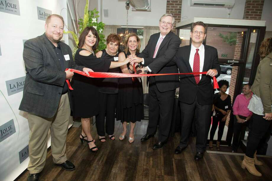 From left, Thomas Madden, director of Economic Development; Cheryl Van Voorhies, co-owner of La Jolie Salon, Color Bar & Spa; Lydia Lupinacci; Toni Ann Lupinacci, co-owner of the salon; Mayor David Martin; Gregory Lodato, of Marlo Associates real estate. Photo: Contributed Photo